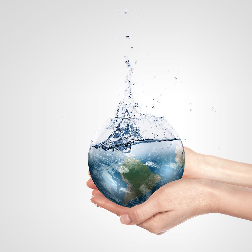 Globe in human hand against blue sky. Environmental protection concept. Elements of this image furnished by NASA.jpeg