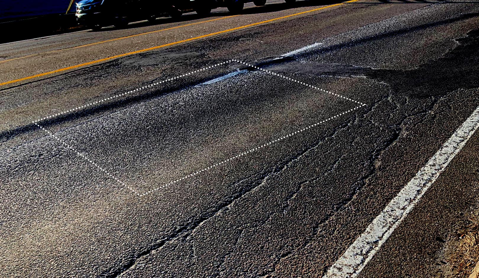 asphalt imperfection in a form of a rutting and shoving